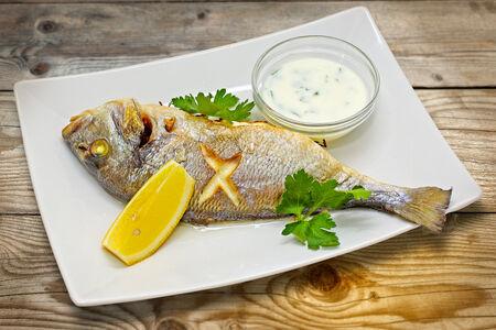 Дорада, запеченная с творожным сыром и лимоном