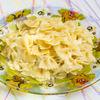 Фото к позиции меню Макароны с топленым сливочным маслом под сыром