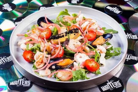 Морепродукты бланшированные в винном соусе
