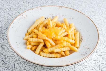 Рифленый картофель фри с сыром