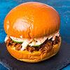 Фото к позиции меню Бургер с рваной свининой BBQ