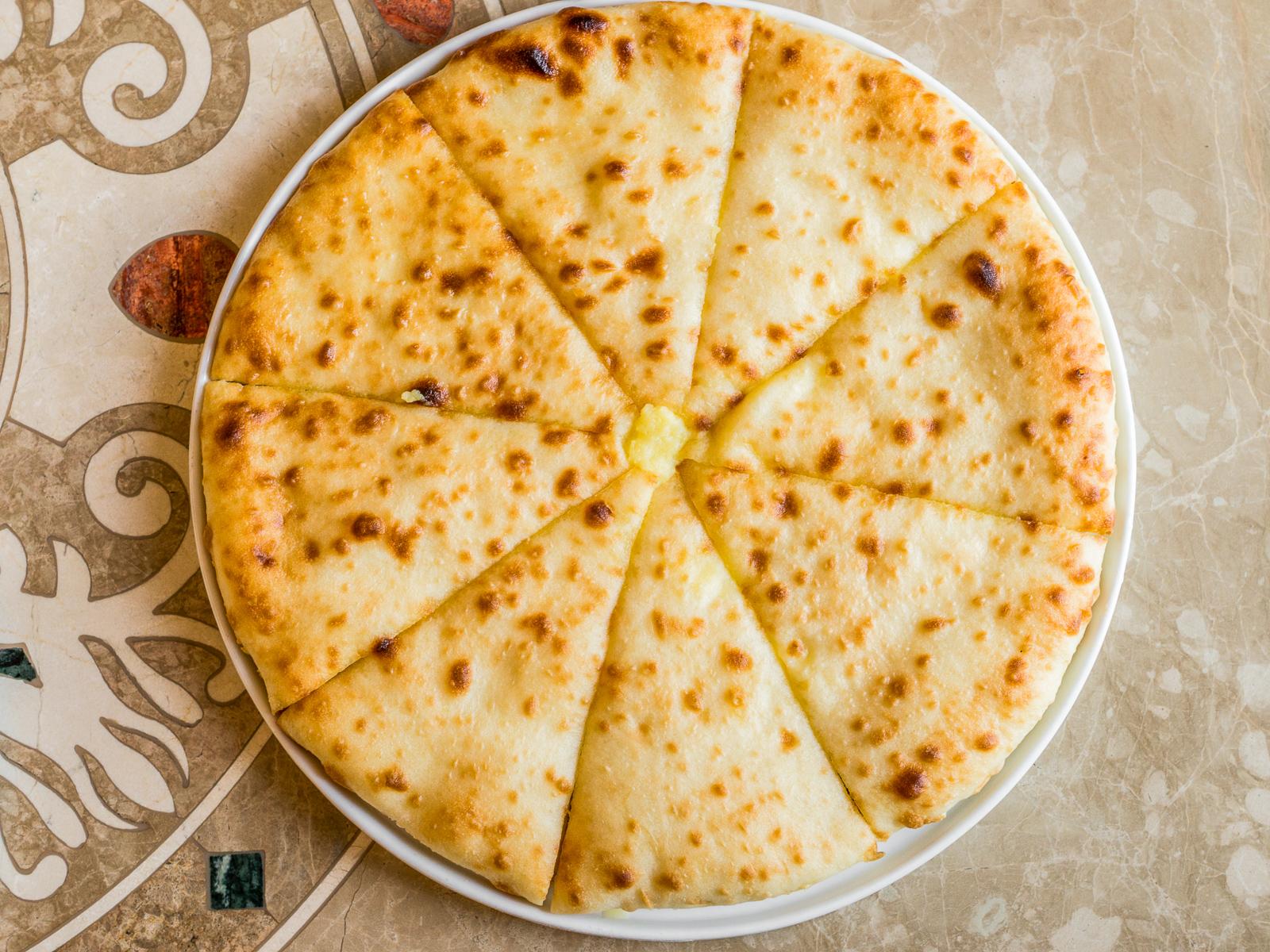 Осетинский пирог с сыром и капустой