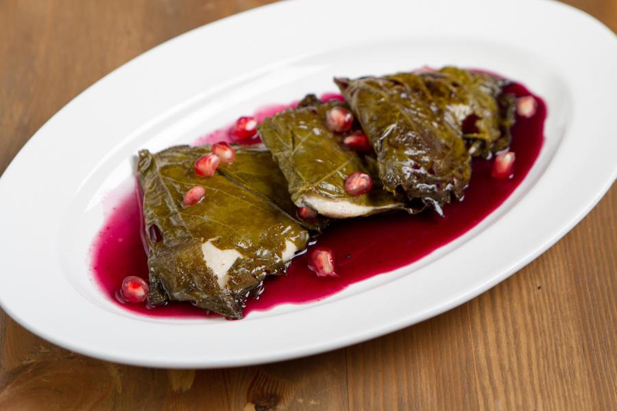 Масляная рыба в виноградных листьях с гранатом