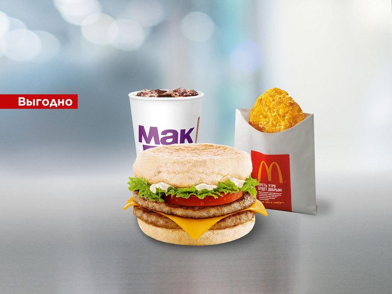 МакКомбо с Двойным Фреш МакМаффином (Двойной Фреш МакМаффин, картофельный оладушек, Кока-Кола 0.4л)