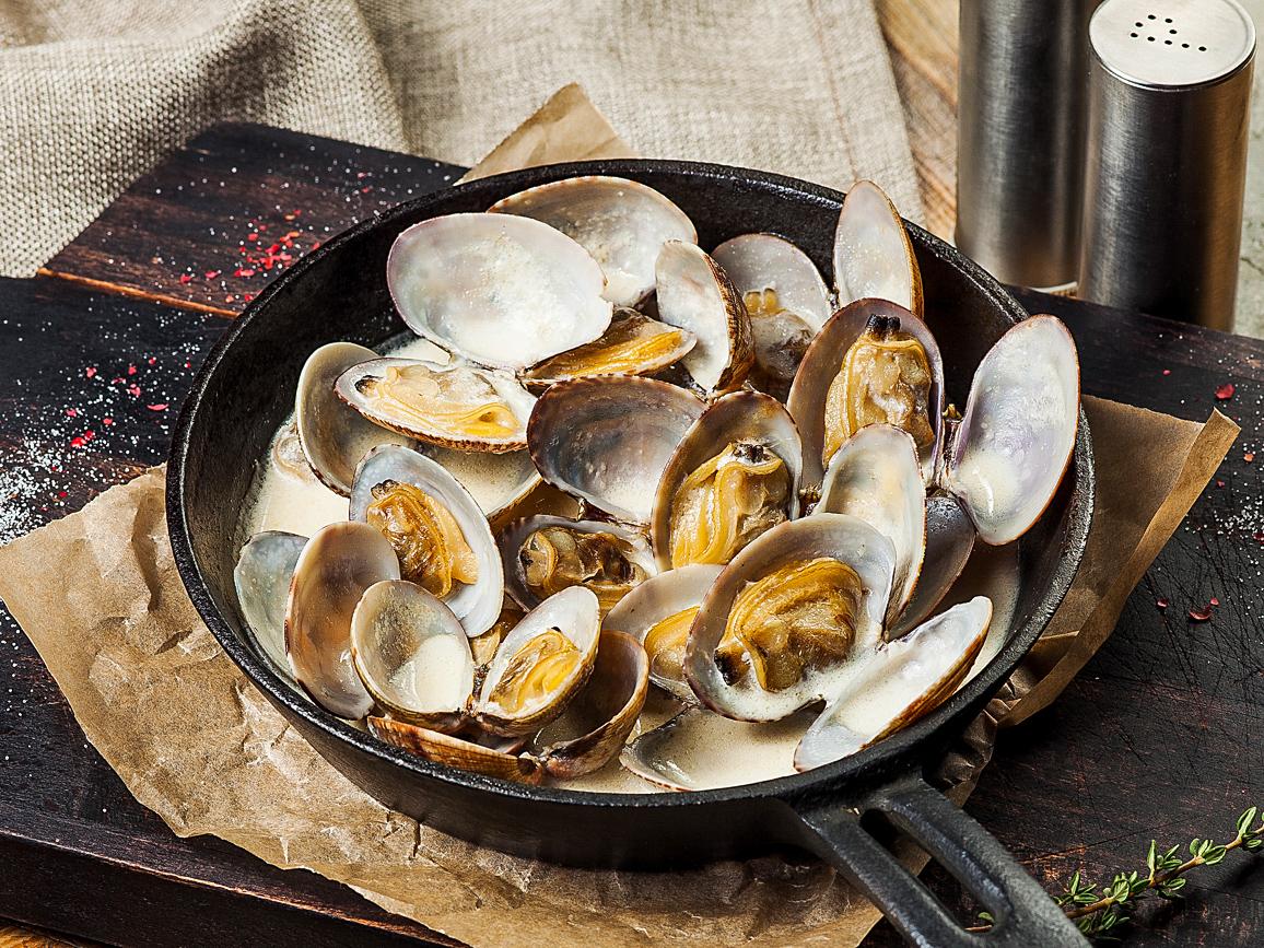 Моллюски в винном соусе