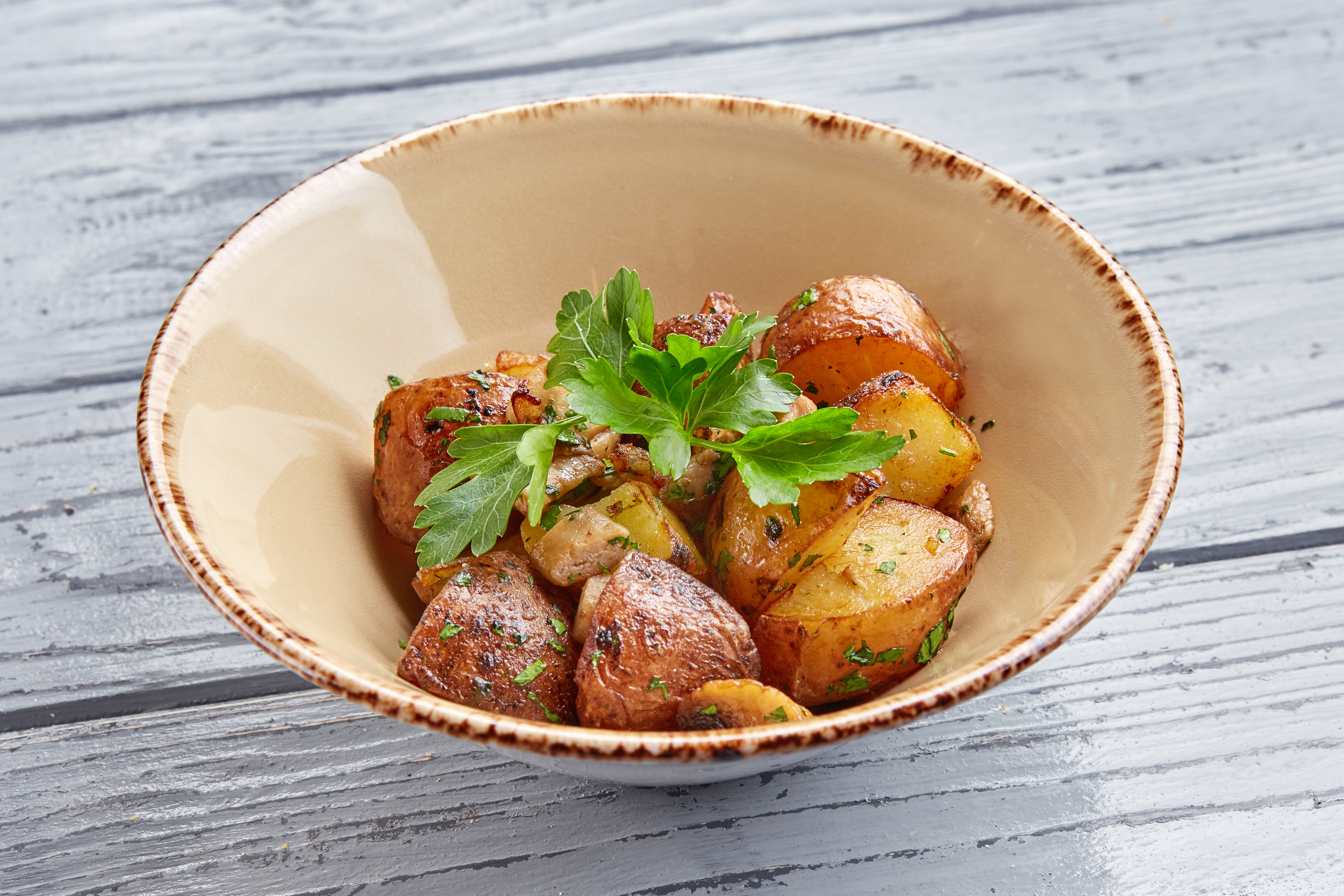 Картофель обжаренный с белыми грибами