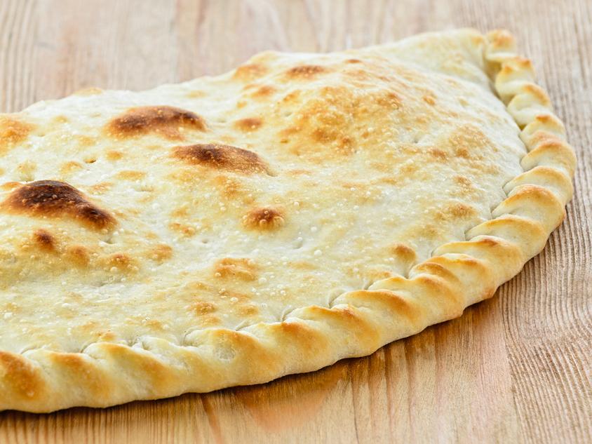 Пицца Кальцоне де Люкс